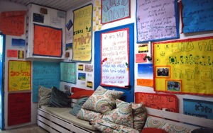 Resting place for the children at the learning center decorated by their posters