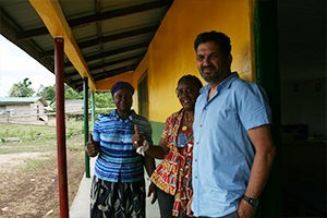 Ran and the manager of the preschools department of Liberia touring the villages